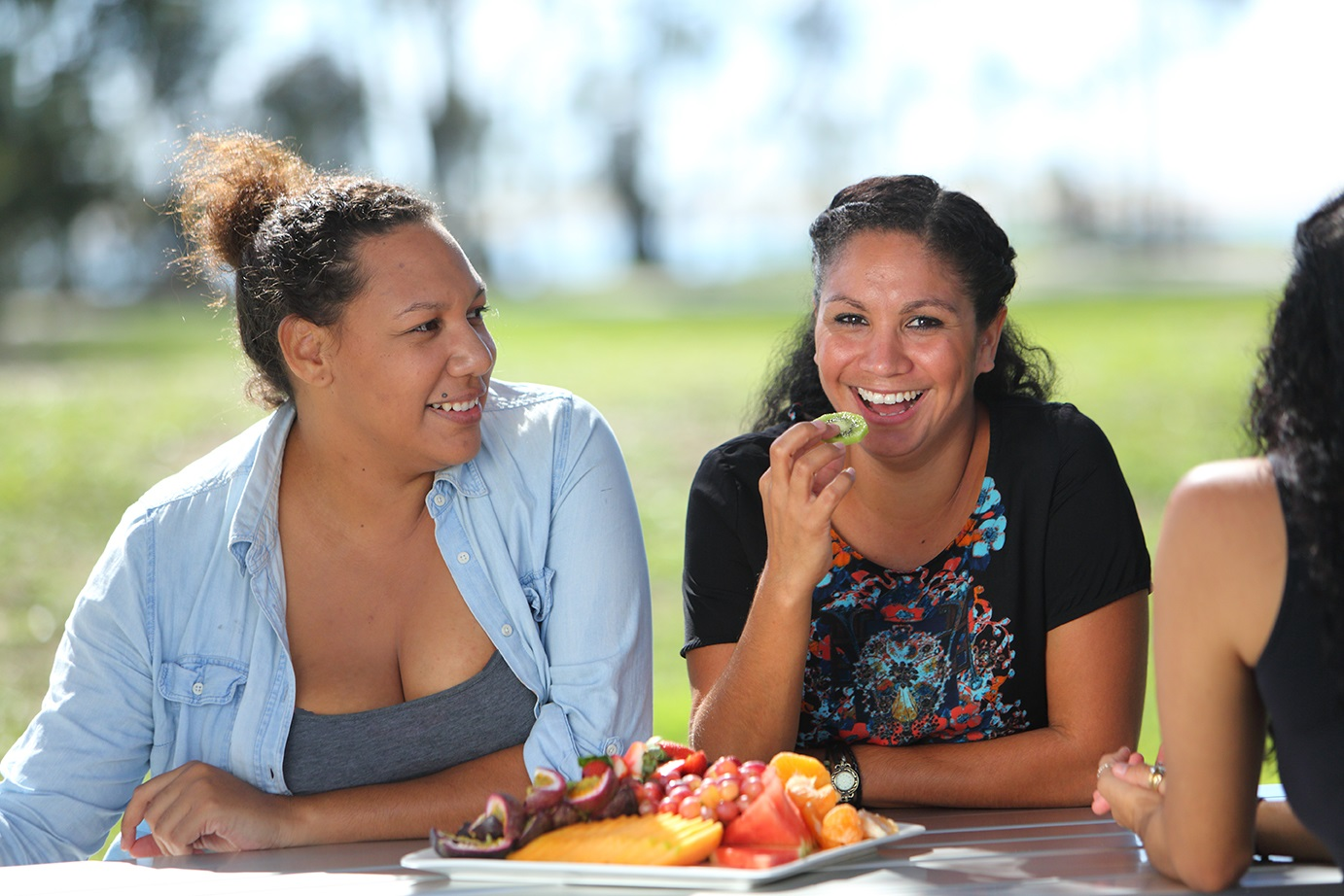 Indigenous women eating fruit