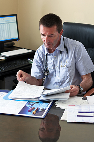 Doctor looking at documents