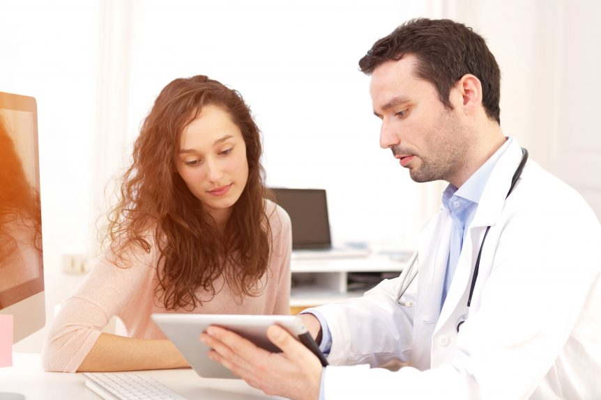Doctor using tablet to inform patient