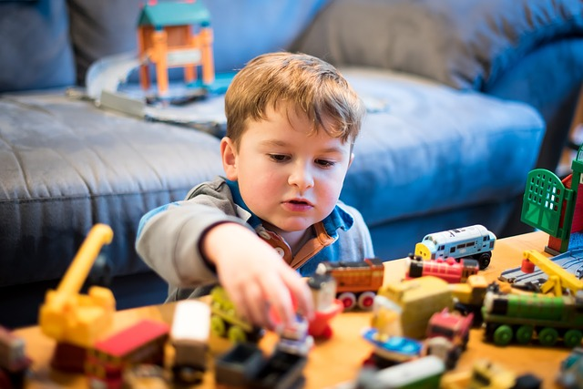Boy with Thomas and friends toys